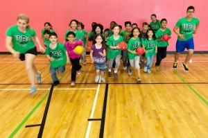 students engaging children in physical activity