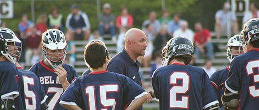 Football coach talking to players in a huddle