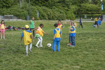 kids playing soccer outside